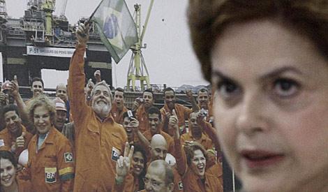 Dilma Rousseff, junto a una fotografía con Lula da Silva. | Reuters