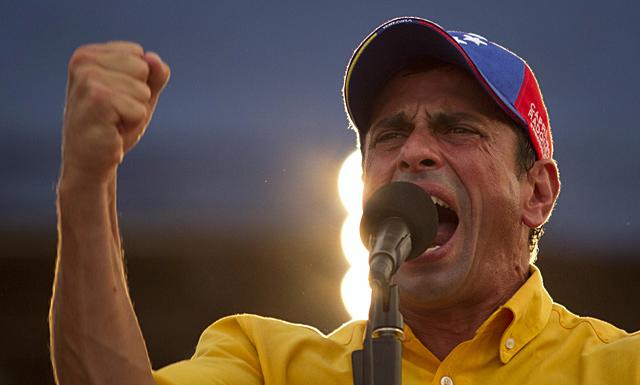 Capriles con su famosa gorra.| Reuters