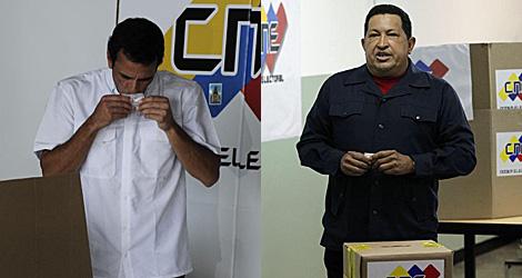 Capriles y Chávez, votando. | Reuters/AFP