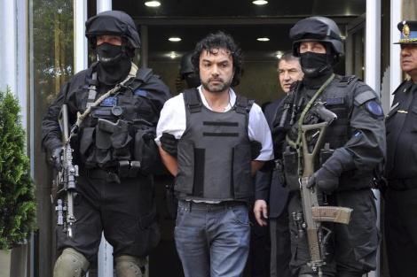 La policía argentina tras la detención del narcotraficante colombiano 'Mi Sangre'. | Efe