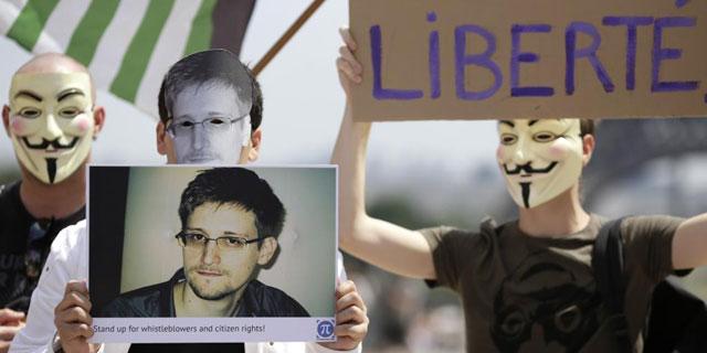 Manifestantes piden la libertad de Snowden. | Afp