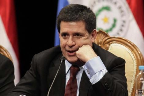 El presidente paraguayo, Horacio Cartes. durante una reunión de trabajo   Reuters