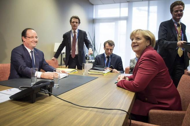 Hollande y Merkel, este jueves en Bruselas.