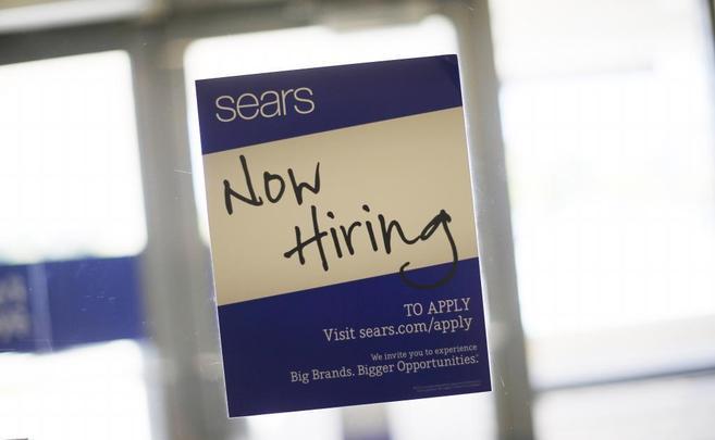 Un anuncio de contrataciones en una empresa de Illinois.