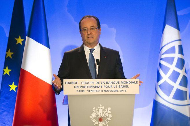 El presidente francés, François Hollande, encargado de organizar la...