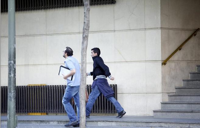 Dos de los responsables de Youkioske, a su salida de los juzgados de...