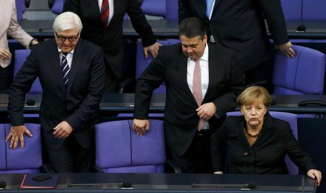 Las tres principales figuras de la Gran Coalición, en el Parlamento.