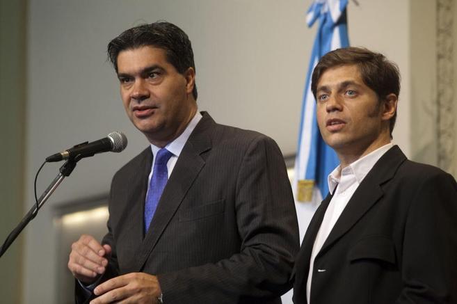 El jefe de Gabinete del Gobierno argentino, Jorge Capitanich, juanto...