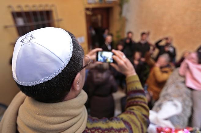 Turistas judíos de origen londinense celebran el Sabat en el Centro...