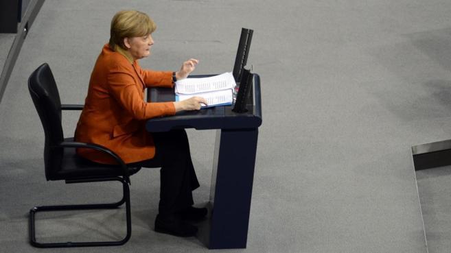 La canciller Angela Merkel pronuncia su discurso en el Parlamento...