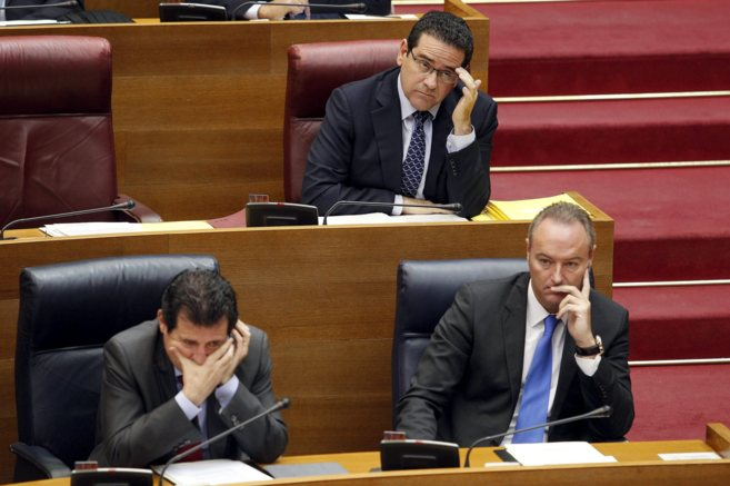 José Císcar, Jorge Bellver y Alberto Fabra, en sus escaños de las...