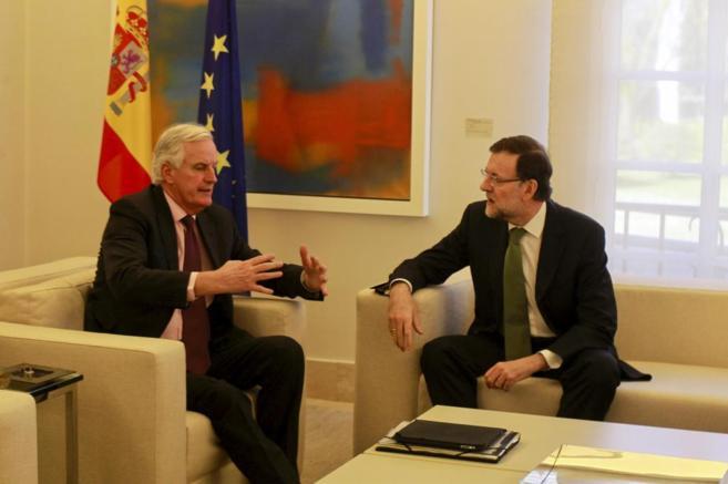 Rajoy, con el comisario europeo de Mercado Interior en la Moncloa.