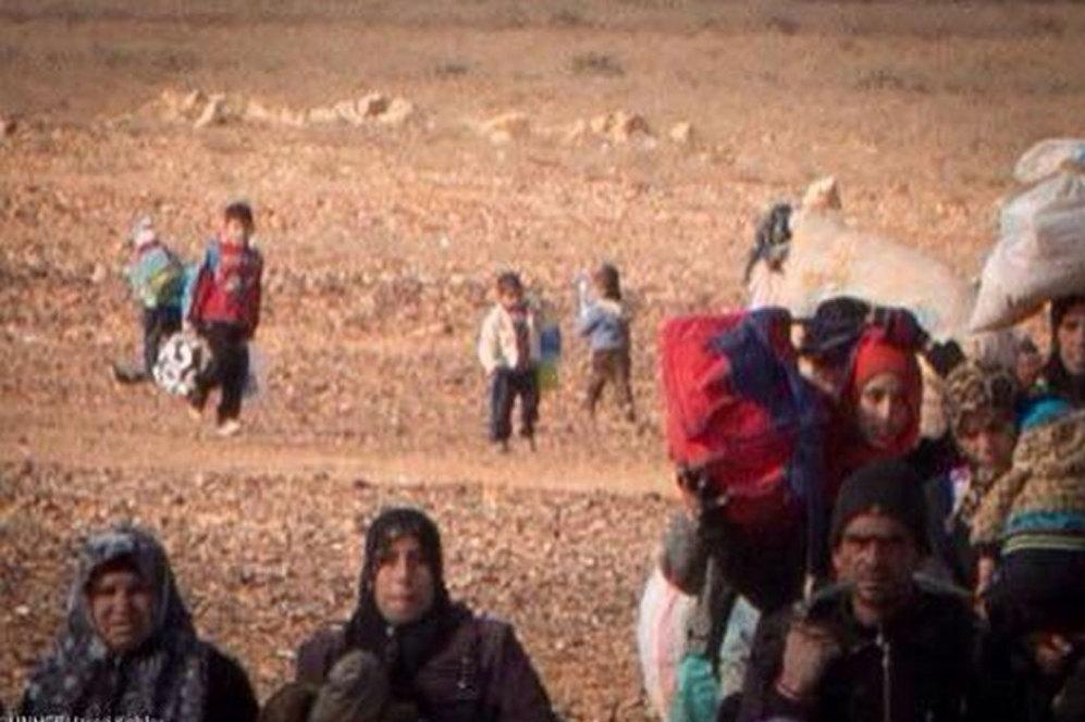 Detalle de Marwan. En esta fotografía se puede ver como Marwan llega junto a otro grupo de refugiados.