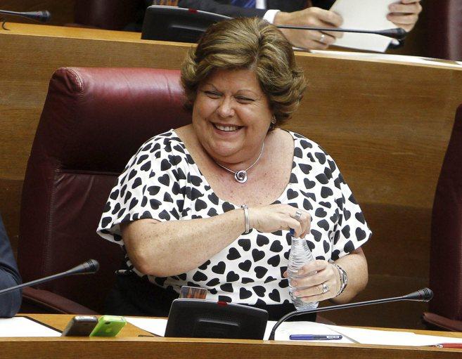La ex consellera de Turismo Milagrosa Martínez, en su escaño de las...
