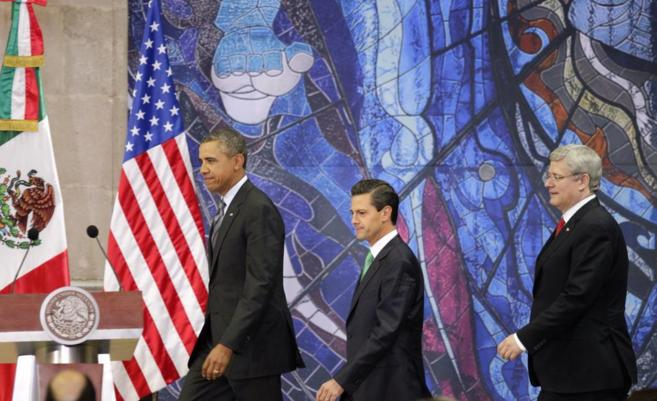 Barack Obama, junto a los presidentes de México y Canadá.
