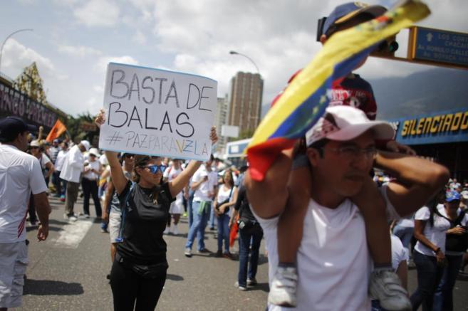 Opositores al Gobierno de Nicolas Maduro protestan en Caracas.
