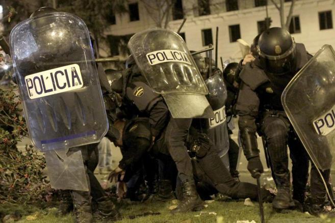 Agentes de la Policía Nacional durante los disturbios en el Paseo de...