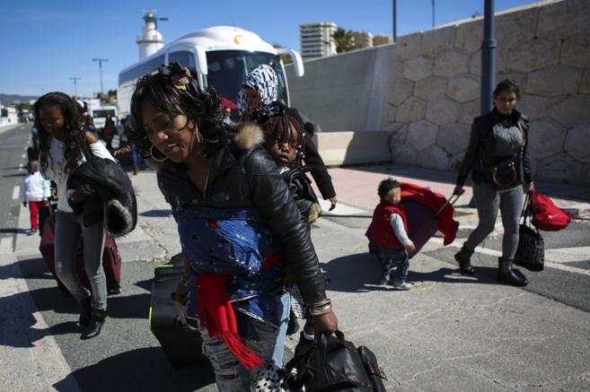 Varios inmigrantes, a su llegada al Puerto de Málaga.