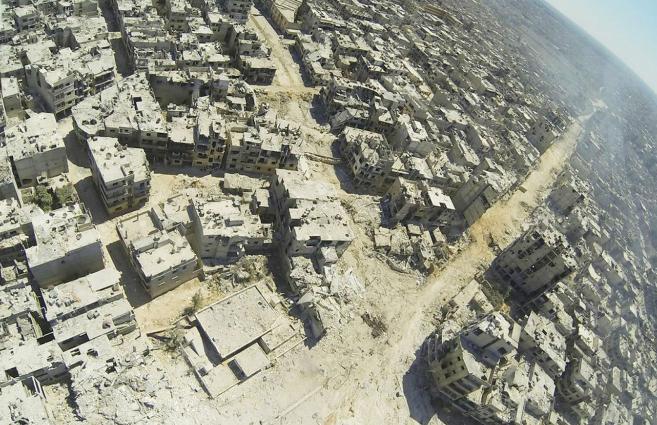 Los rebeldes que resistían en Homs se retiraron el miércoles. Unos...