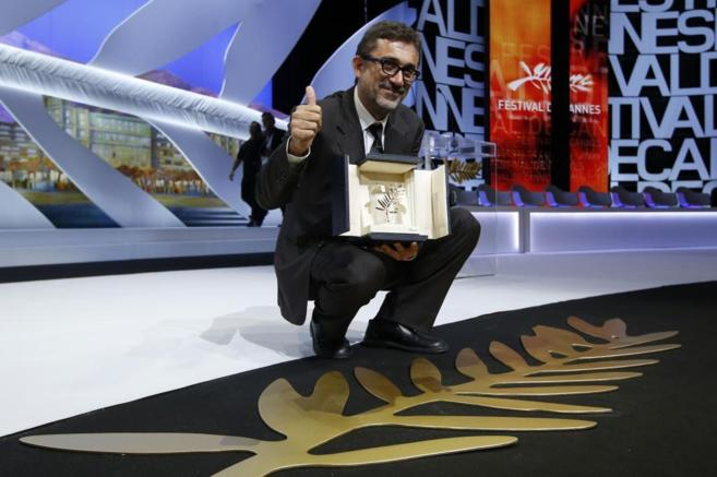 El director turco con su Palma de Oro.