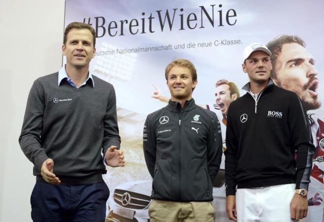 Rosberg entre el Oliver Bierhoff y Martin Kaymer.
