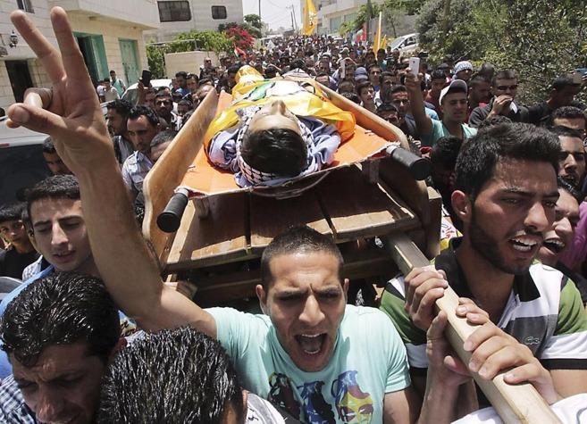 Entierro del adolescente palestino Mohamed Dudin en la localidad de...