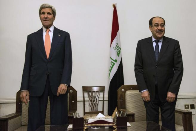 John Kerry (izda.) y Nuri Maliki, durante su encuentro en Bagdad.