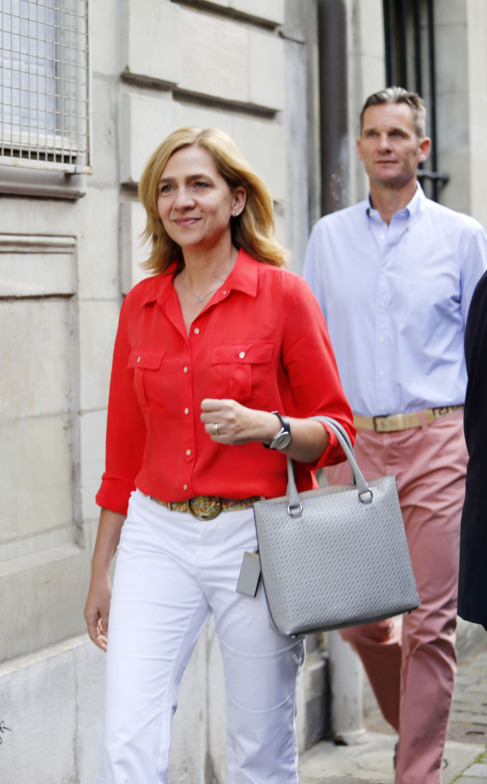 La Infanta Cristina y Urdangarin, ayer en Ginebra.