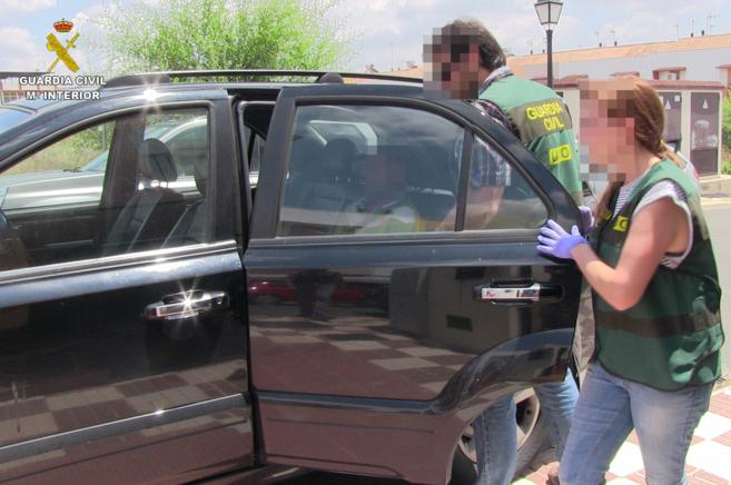 El presunto autor del doble crimen, trasladado en un coche de la...