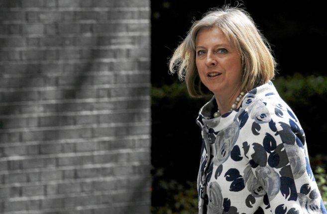 La ministra de Interior, Theresa May, a su llegada al número 10 de...