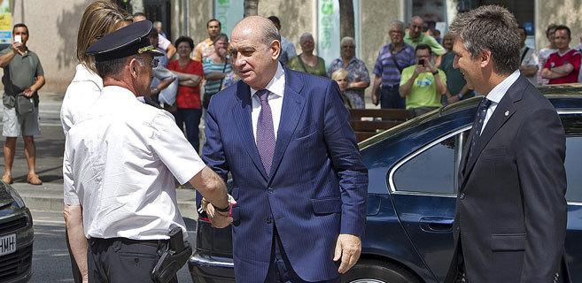 El ministro del Interior, Jorge Fernández, y el director general de...