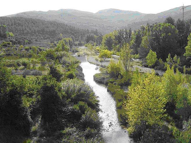 El río Mijares antes de las actuaciones de la maquinaria pesada