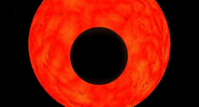 Simulación artística del planeta Kepler 91-b, en negro, y la...