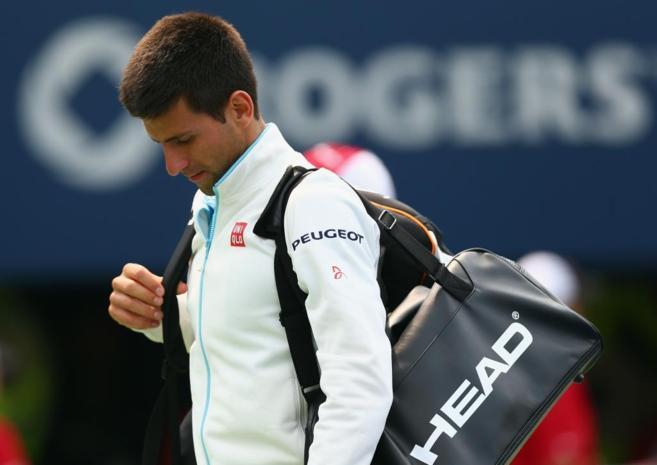Djokovic, con gesto cabizbajo tras su derrota.