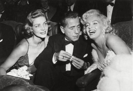 Laurent Bacall junto a Humphrey  Bogart y Marylyn Monroe.