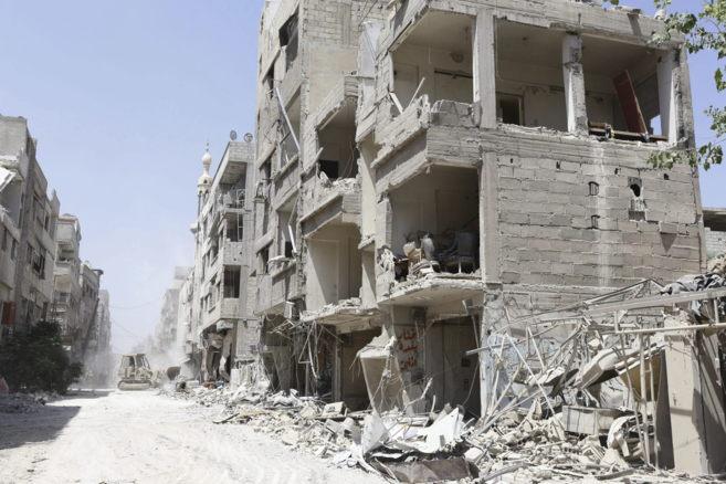 Una calle destruída en la ciudad de Mleha, en las afueras de Damasco.