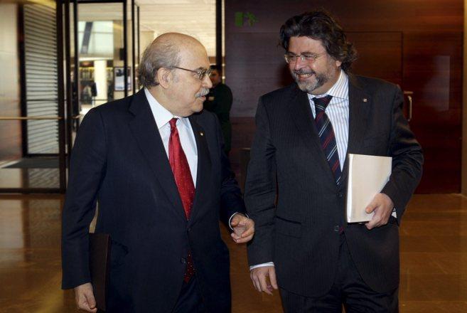 El conseller, Andreu Mas-Colell, conel secretario de Universitats i...
