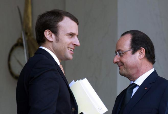 El nuevo ministro de Economía francés, Emmanuel Macron, y Francois...