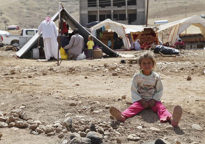 Una niña yazidí en un campamento de refugiados de Zajo, ciudad del...