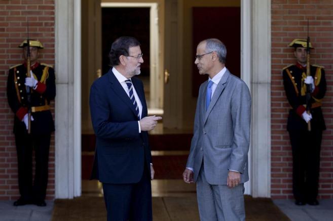 Mariano Rajoy y Antoni Martí, en las puertas del Palacio de la...