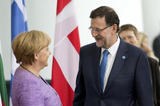 La canciller alemana, Angela merkel, y el presidente del Gobierno,...