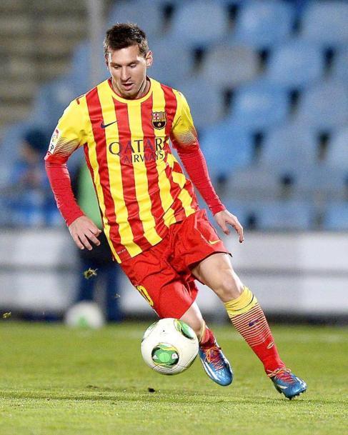 Messi, durante un partido con la camiseta de la 'senyera'.