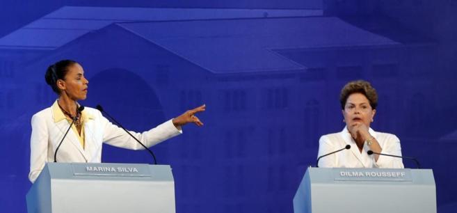 Las candidatas a la presidencia de Brasil Silva (PBS) y Rousseff (PT)...
