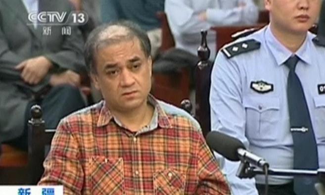 El académico uigur Ilham Tohti, durante el juicio en Urumqi...
