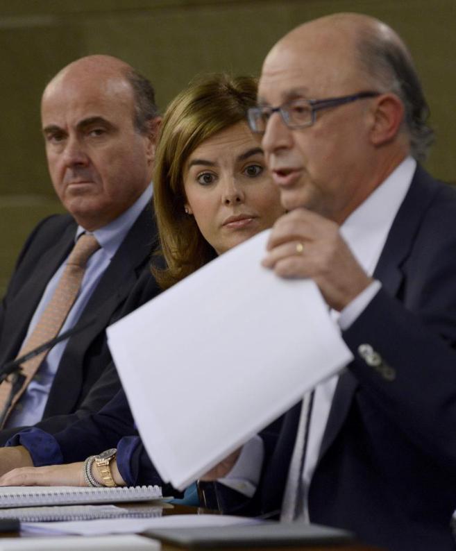 Cristóbal Montoro, Soraya Sáenz de Santamaría y Luis de Guindos,...