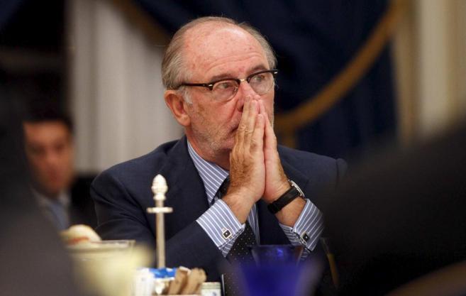 El ex presidente de Caja Madrid Rodrigo Rato, con las manos en la boca