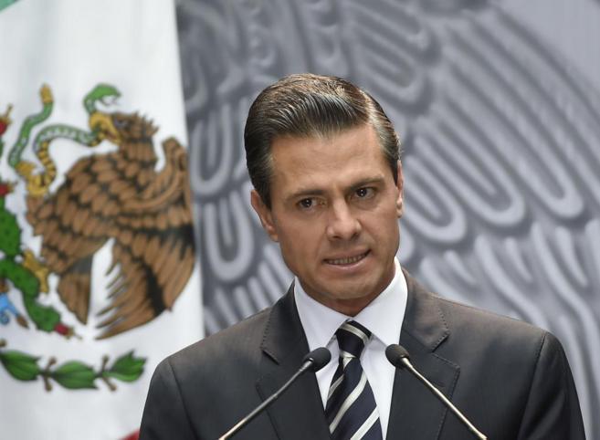 El presidente de México, Enrique Peña Nieto, durante la emisión del...