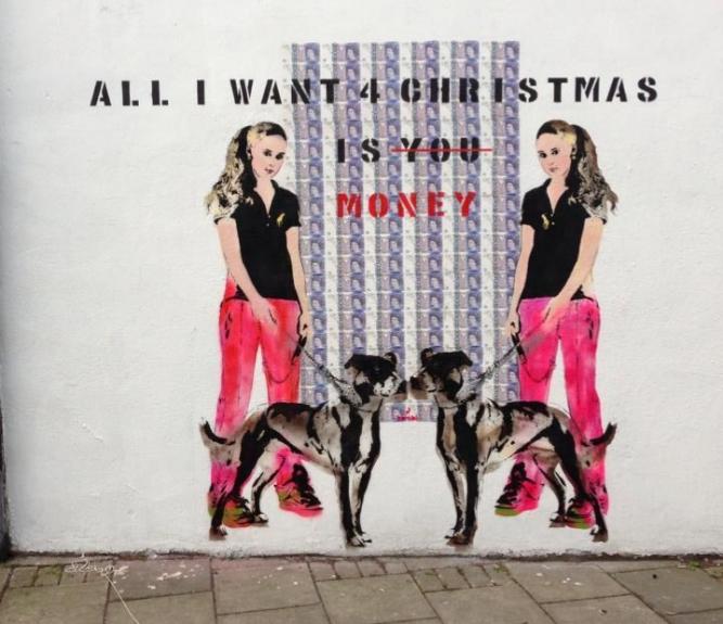 Mural titulado 'Todo lo que quiero para Navidad es dinero'