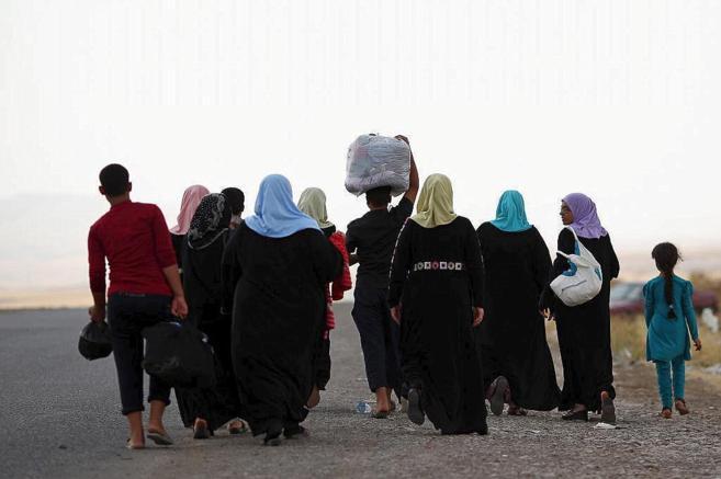 Refugiados iraquíes, desplazados por el avance del IS.