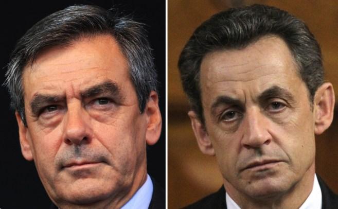 El ex primer ministro francés François Fillon (izqda.)  y el ex...
